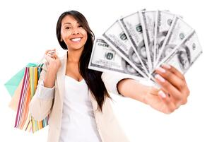 Happy shopping woman with a lot of money - isolated over white
