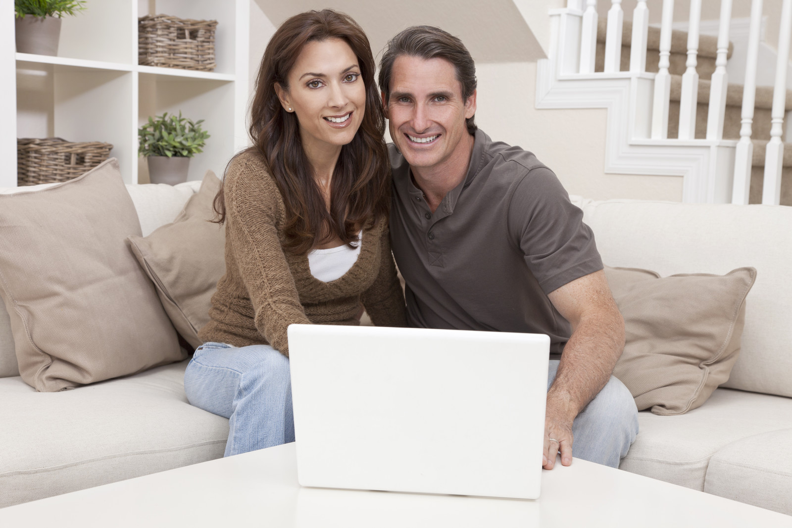 Couple in home w computer stock.jpg